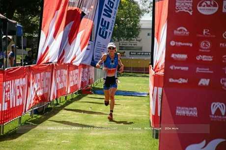 BLITZED: Celia Sullohern approaches the finish line.
