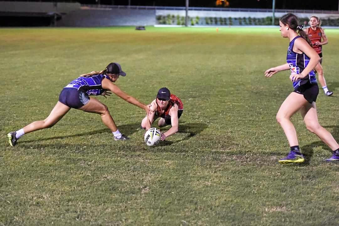 A touch player displays their speed during the Ipswich Touch Super 8's competition.