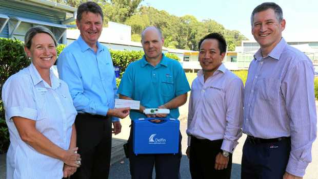 Mid North Coast Cancer Insitute staff accept the well-needed donation from the Coffs City Rotary Club.