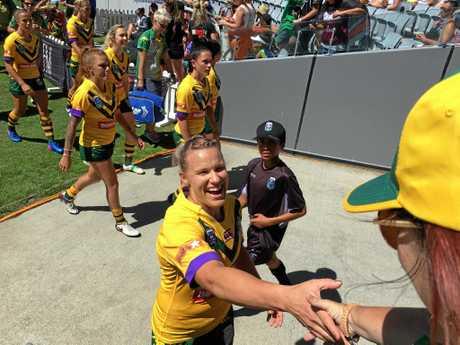 Australian Jillaroos captain Renae Kunst spots some Mackay fans in the crowd at Auckland Nines.
