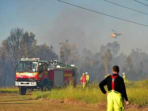 Boys playing with lighter spark suburban bushfire