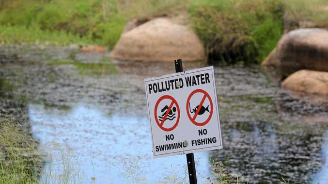 Warning signs have been erected at Quart Pot Creek after a sewage pipe was damaged, polluting the waterway.