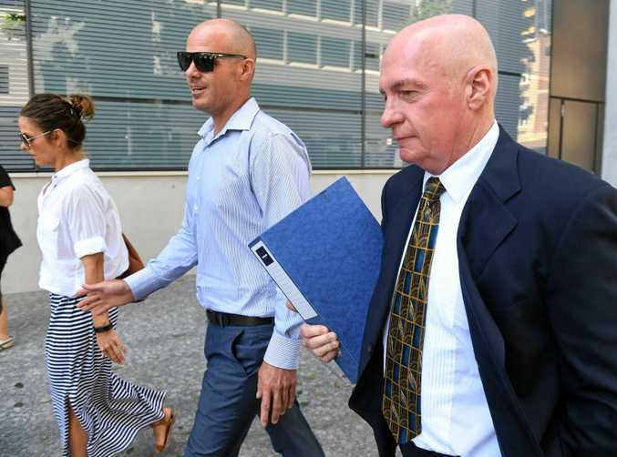 Former Queensland Labor minister Gordon Nuttall (right) leaves the supreme court in Brisbane with son Andrew (c) and daughter Lisa (l), Thursday, Feb. 8, 2017. Nuttall , currently on parole after being convicted for corruption, is attempting to stop the Queensland government from taking his superannuation.(AAP Image/Dave Hunt) NO ARCHIVING