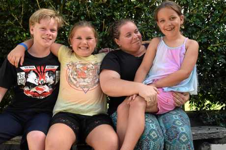 LUCKY: Jonah, Charlie, Emma Blackburn and Ruby feel lucky after a charger caused their house fire in Coffs Harbour on Tuesday night.