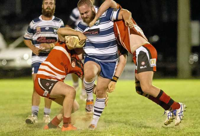IN ACTION: Brothers player Cohen Haines is tackled by Valleys opponents last season.