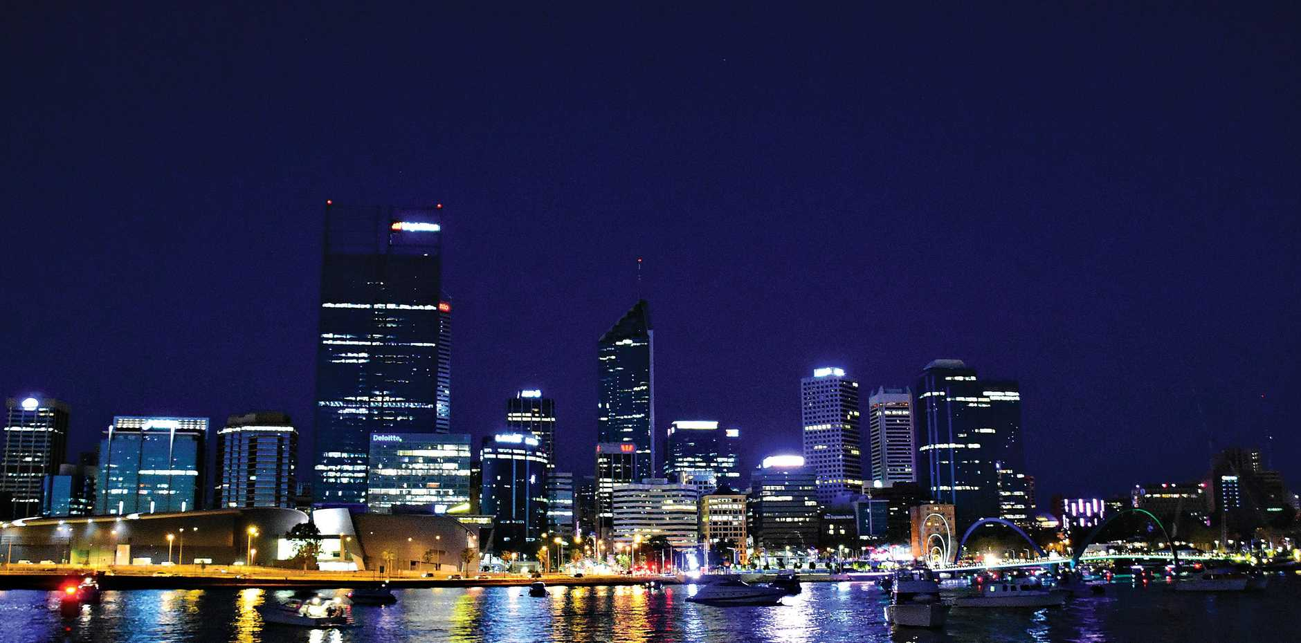 The Perth skyline by night is one of many sights to take in during a 15-day trip across Australia.