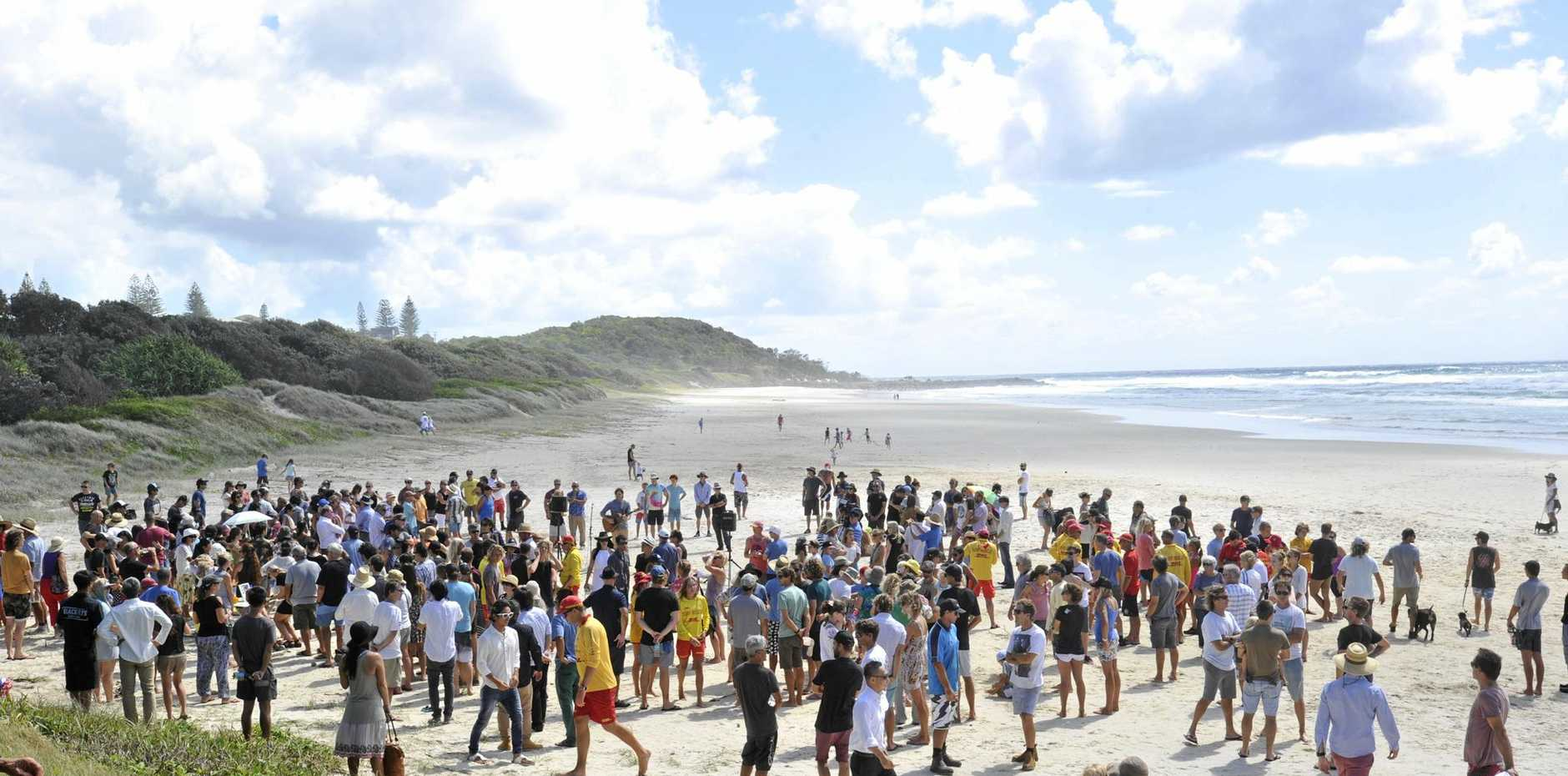 GRIEF AND TRAUMA: There was a large turnout at Shelly Beach for the memorial service of local surfer Tadashi Nakahara, who died in a shark attack at the popular surfing spot on February 9, 2015.