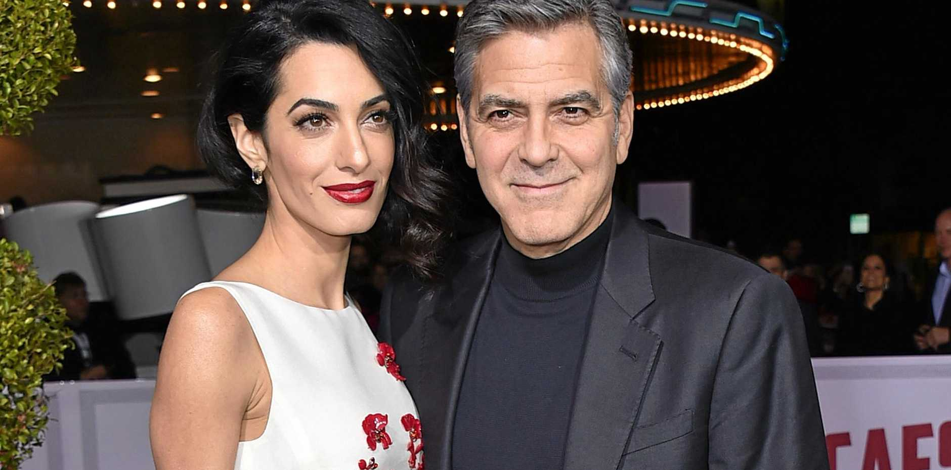 Amal Clooney, left, and George Clooney.