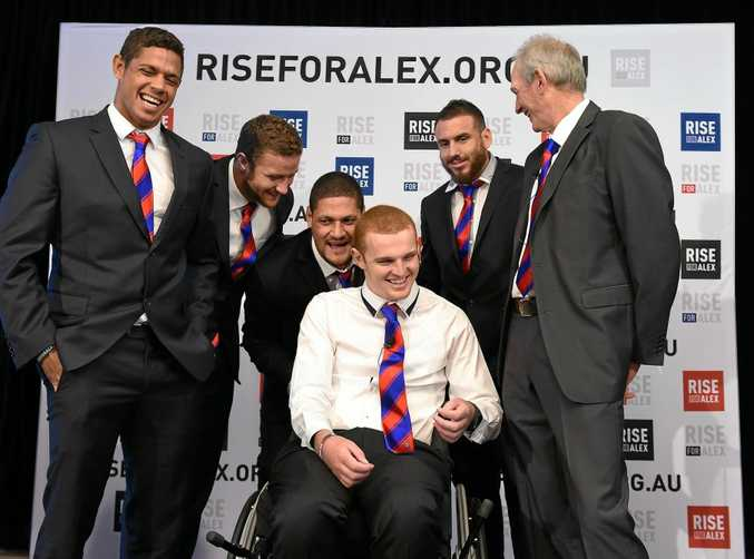 Former Newcastle Knights NRL player Alex McKinnon (centre), is surrounded by (from left) former Knights teammates Dane Gagai, Korbin Sims, Willie Mason and Darius Boyd and coach Wayne Bennett in 2014.