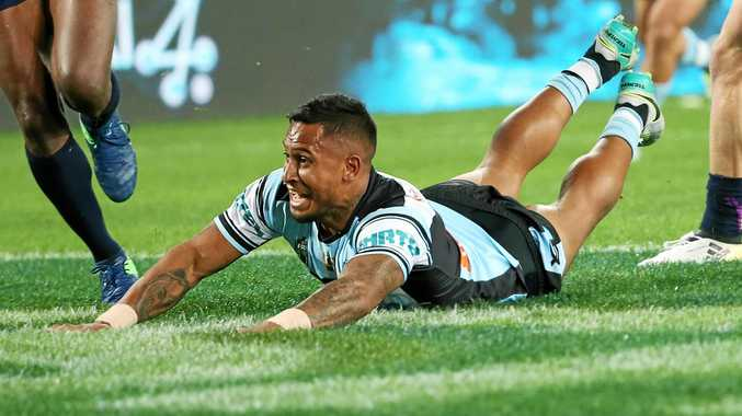 Ben Barba of the Sharks scores the first try of the match during the 2016 NRL grand final.