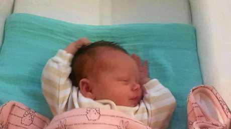 TUCKED UP: Newborn baby, Harpah Leeson sleeping peacefully at home.