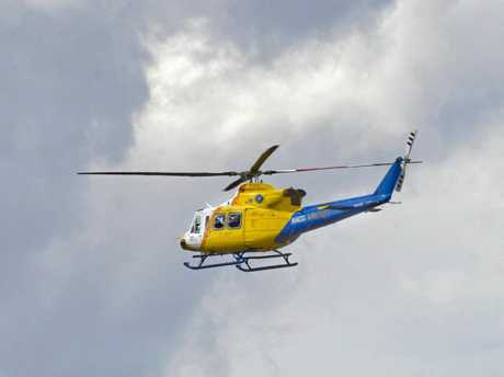 RACQ LifeFlight helicopter transported a woman to Bundaberg Hospital with a head injury after a boat she was in capsized.