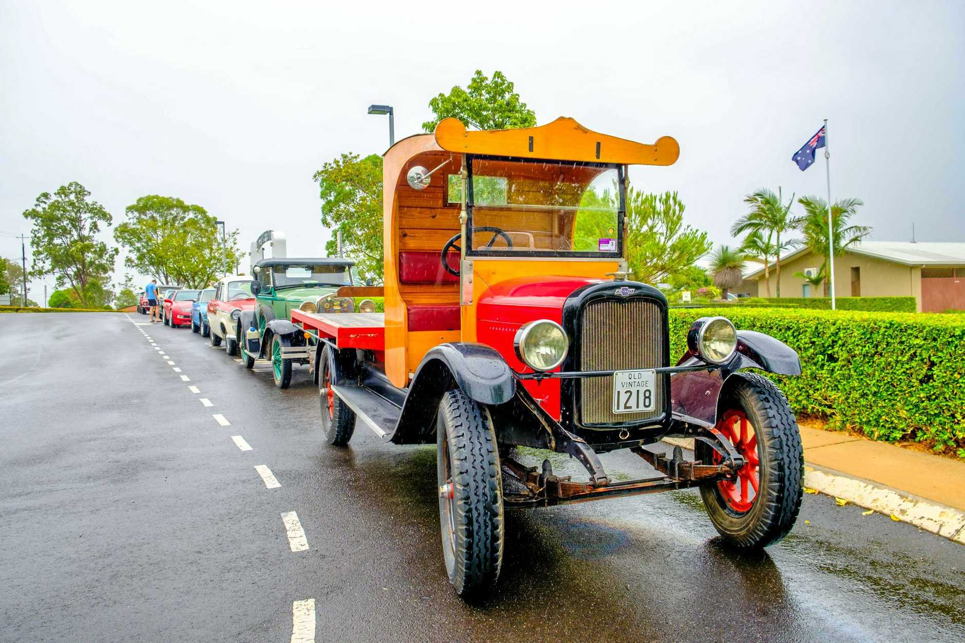 Historic cars line up outside Victory College.