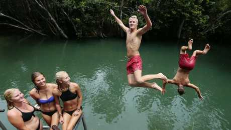 Backpackers Juuso Vehvilainen and Jonas Niemollercool off at Four Mile Creek swimming hole near Cardwell.