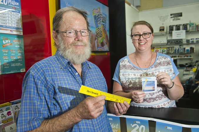 MEASURING UP: Stephen Jones receives his Ultimate Fishing Giveaway ruler from Kristell Meek at the Northlands Newsagency. Saturday Feb 11, 2017.