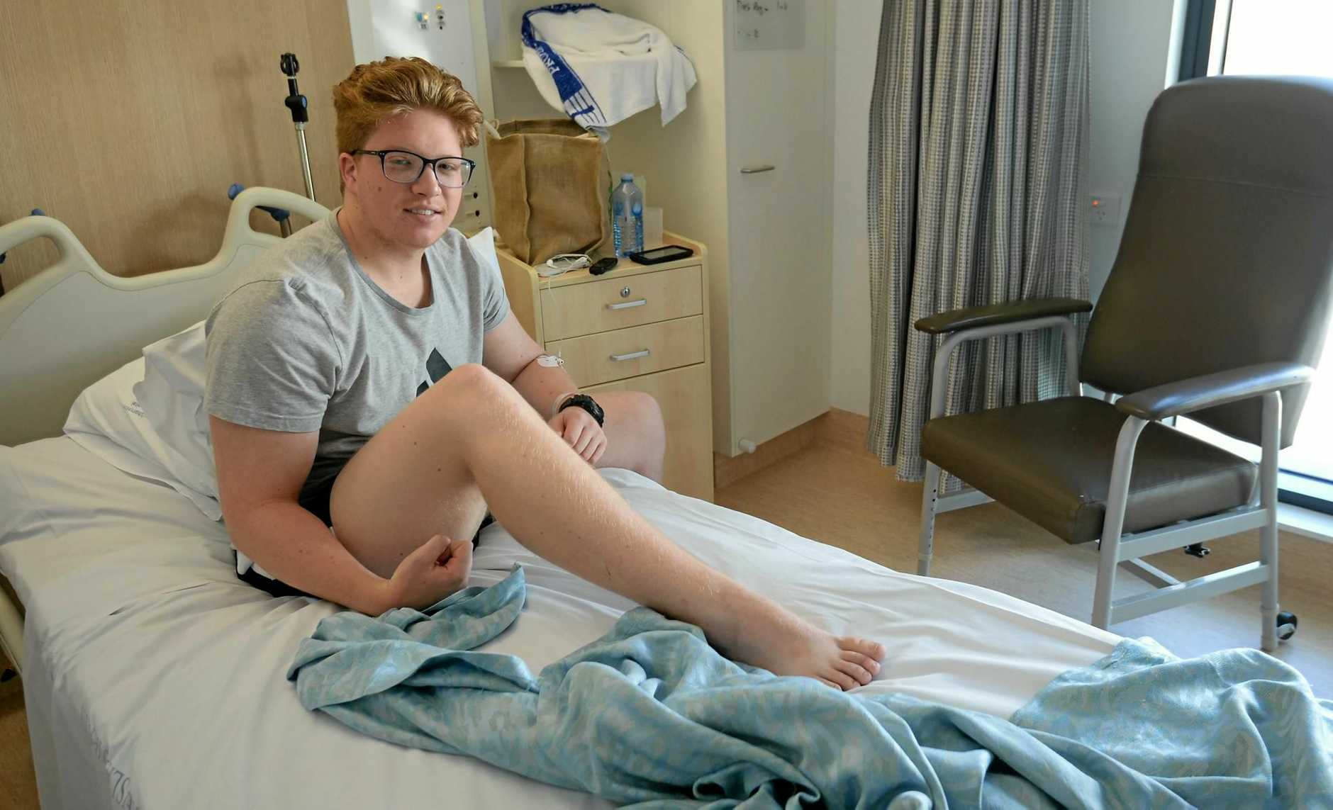 OUCH: Harry Molloy recovering in hospital after being bitten on the toe by a snake.