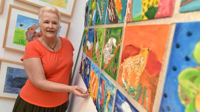 Hervey Bay Regional Gallery - new exhibition 'Be Bold, Be Brave, Believe!' from students at the ArtAbility Studio. Art teacher Anne Ham with 'Our Aussie Animal Quilt' painted by students aged 8-12 years.
