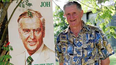 Former Member for Cooroora Gordon Simpson with an old poster of Sir Joh Bjelke Peterson in 2005.
