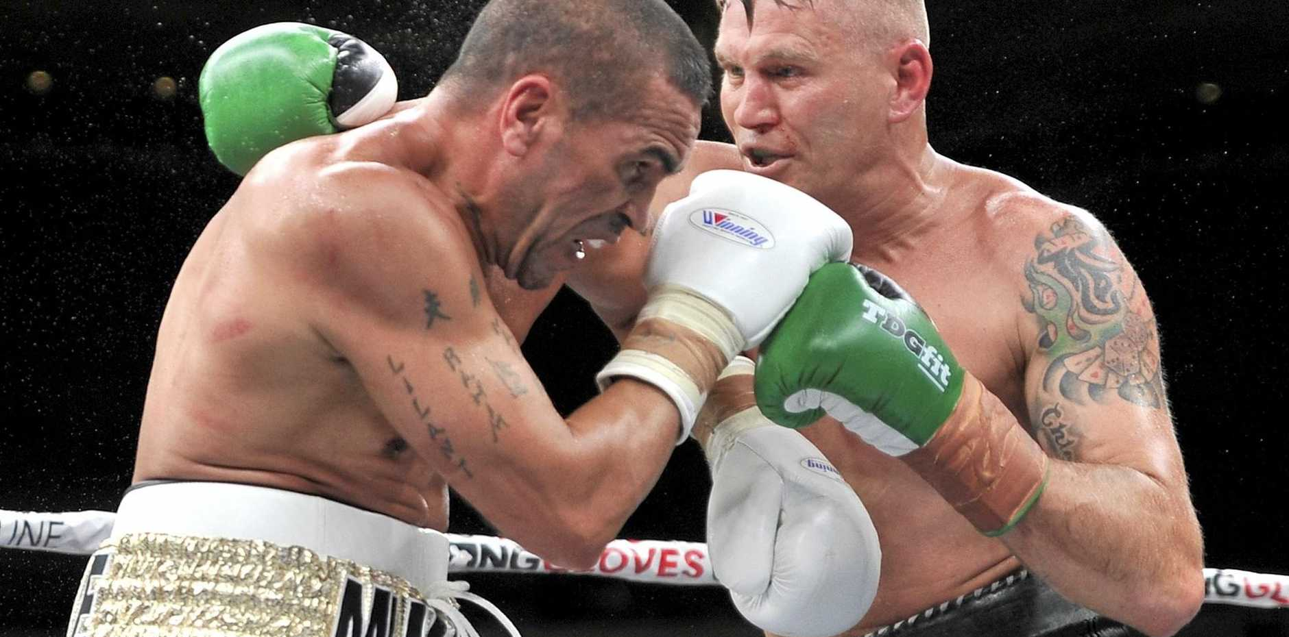 Danny Green and Anthony Mundine slug it out.