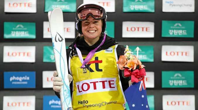 Britteny Cox celebrates winning the FIS Freestyle Ski World Cup 2016/17 Womens Moguls Final at Bokwang Snow Park