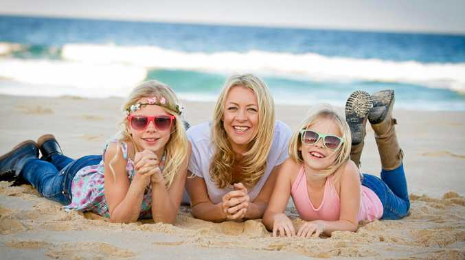 MUMMA LOVIN': Sunrise Beach 'mumpreneur' Lucy Good, photographed with daughters Amber and Ruby, is out to give single mothers a great Valentine's Day.