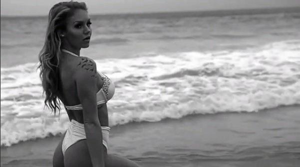 SPLASHING ABOUT: Playboy model Jasmine Ferguson splashes a new swimwear line at Sawtell.