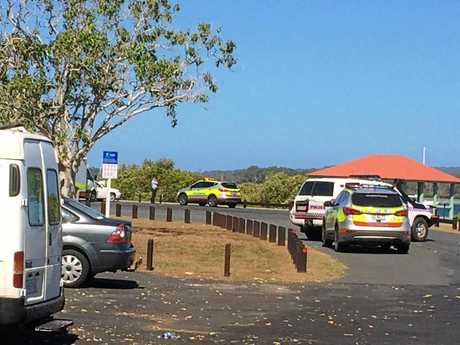 Ambulances attend the scene of a water incident at Tin Can Bay involving a man and a child.