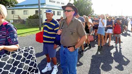 LONG WAIT: Fans line up in Casey Ave outside BB Print Stadium waiting to get in to see the Cowboys in action against the Roosters on Saturday.