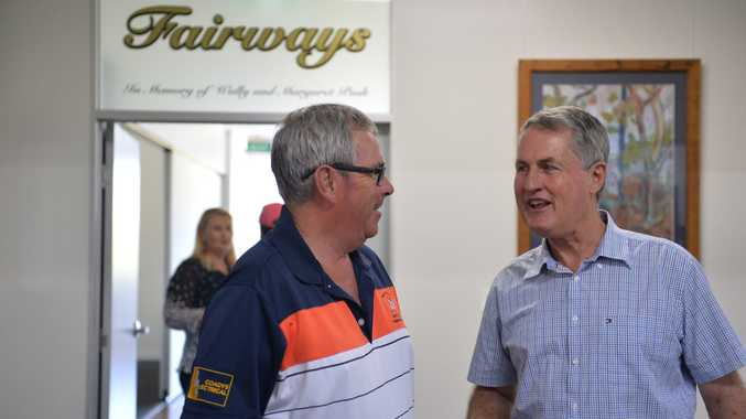 Mayor Greg Williamson (right) and Mackay Golf Club member Peter Walker. The club received a Better Community Building Fund grant in 2015-16. Photo: Daily Mercury