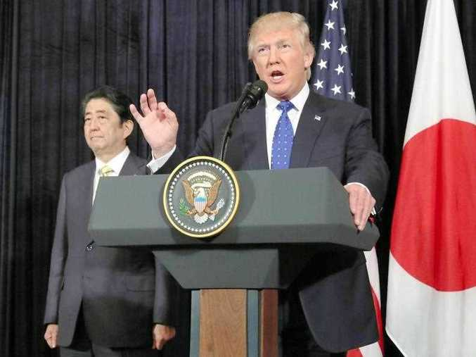 U.S. President Donald Trump (R) and Japanese Prime Minister Shinzo Abe attend a joint press conference in Palm Beach, Florida, on Feb. 11, 2017, responding to the latest ballistic missile launch by North Korea.