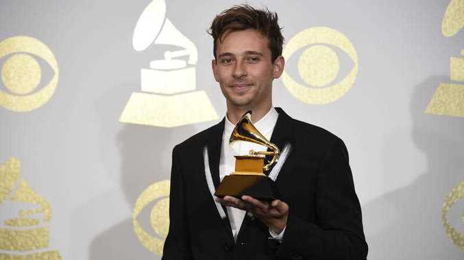 Flume poses in the press room with the award for best dance/electronic album for