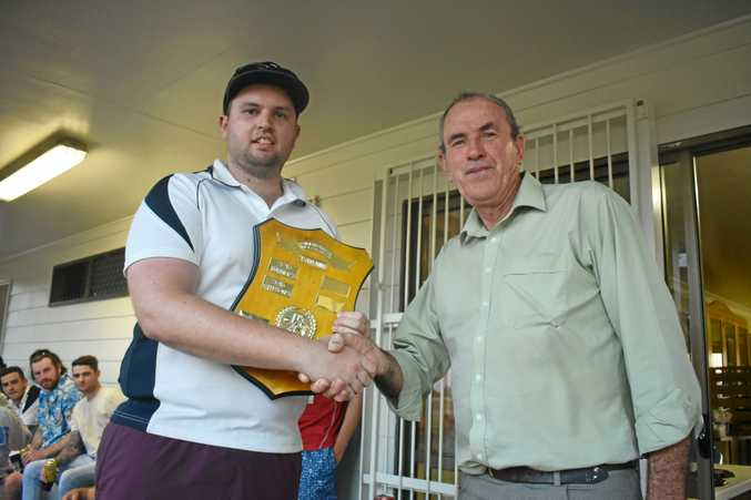 WINNERS: Sam Gleeson from 'Sleepy 7s', Division 1 winners at the Dalby Cricket Carnival, with John Marshall.