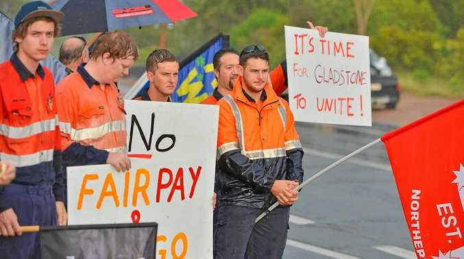 NRG workers protest out front of the power station.