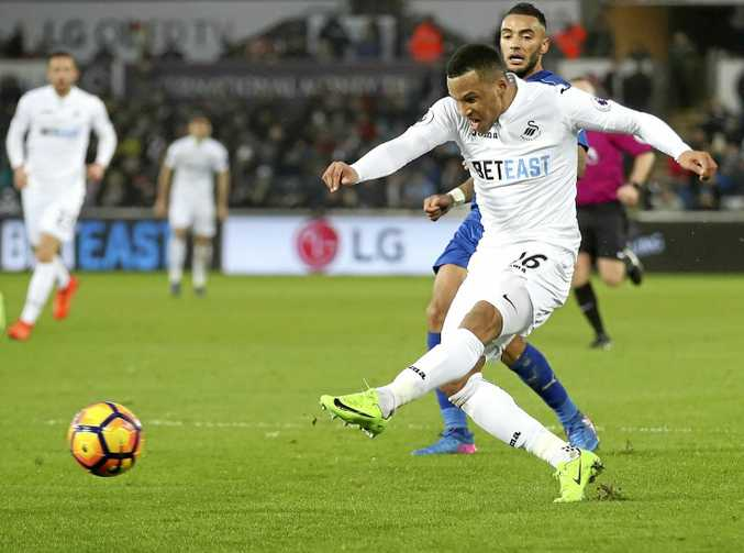 Swansea City's Martin Olsson scores his side's second goal in the 2-0 EPL win over Leicester City.