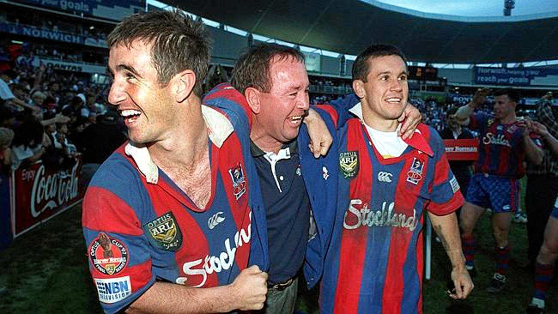 Matthew Johns (right) celebrates the Knights' 1997 grand final with brother Andrew (left). Photo: News Ltd