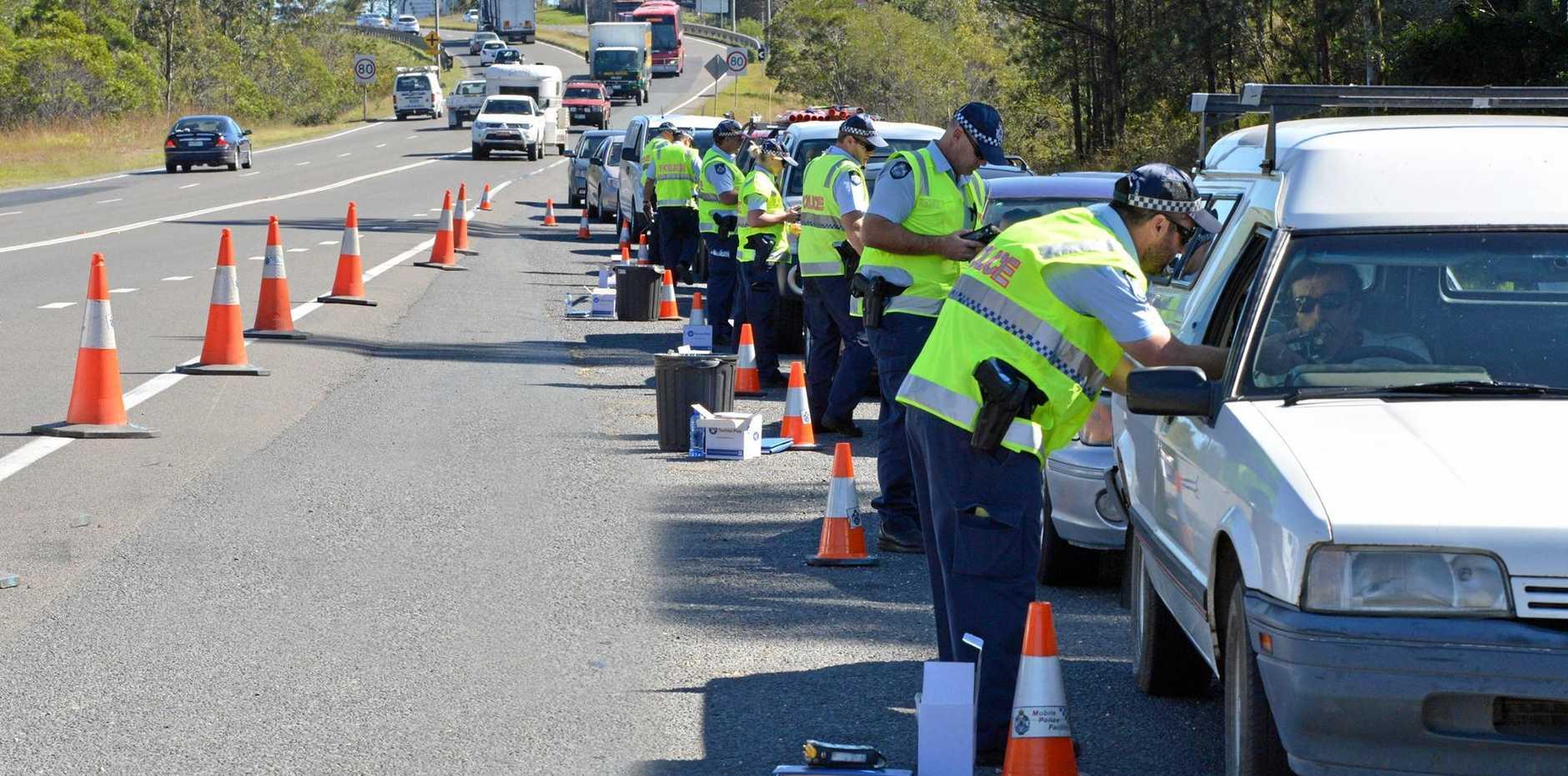 Police roadside blitz, licence, breath test, rego, drugs on the Bruce Hwy.