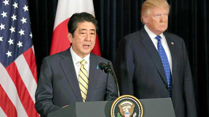 Japanese Prime Minister Shinzo Abe (left) and U.S. President Donald Trump meet with reporters in Palm Beach, Florida, on Saturday, following the latest ballistic missile launch by North Korea.