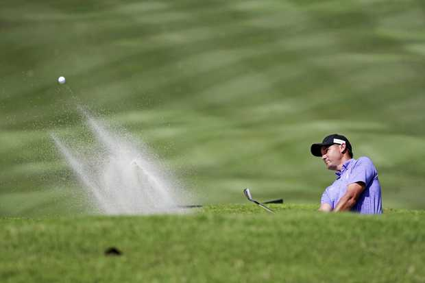 Sam Brazel tees off inside the bunker during round 3 of the Maybank Championship golf tournament in Subang, near Kuala Lumpur, Malaysia.