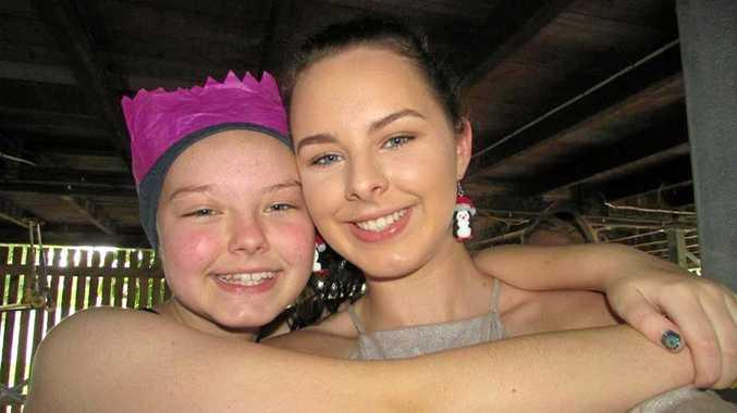 Rockhampton schoolgirl Hannah Tarlington (left) with her older sister Nicole.