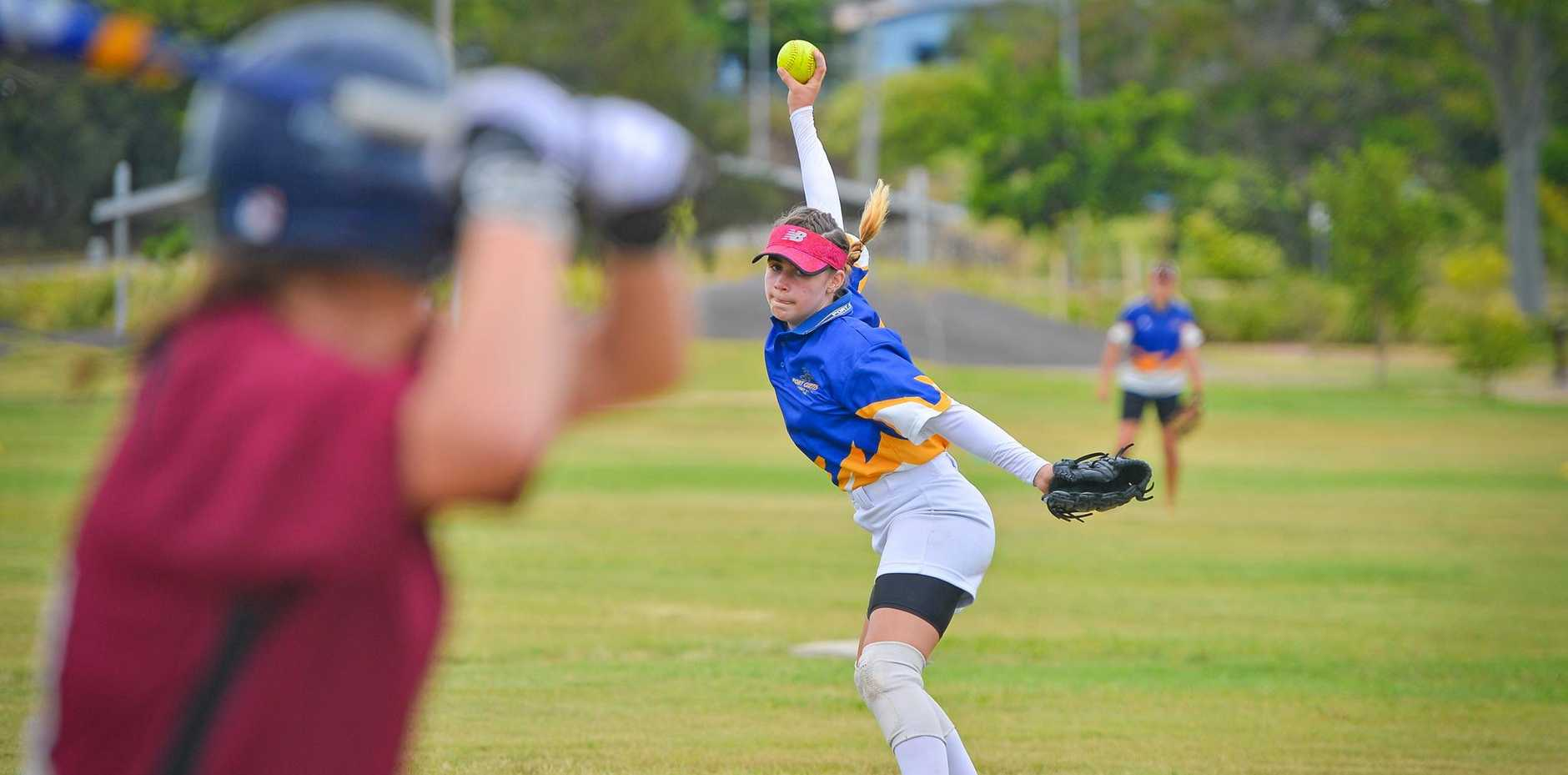 Kirsty Lester, 12, trying out for the 13-19 years Port Curtis School Softball trials yesterday.