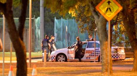 Police outside the University of Southern Queensland's Clive Berghofer Recreation Centre on Baker St on Monday night investigate an