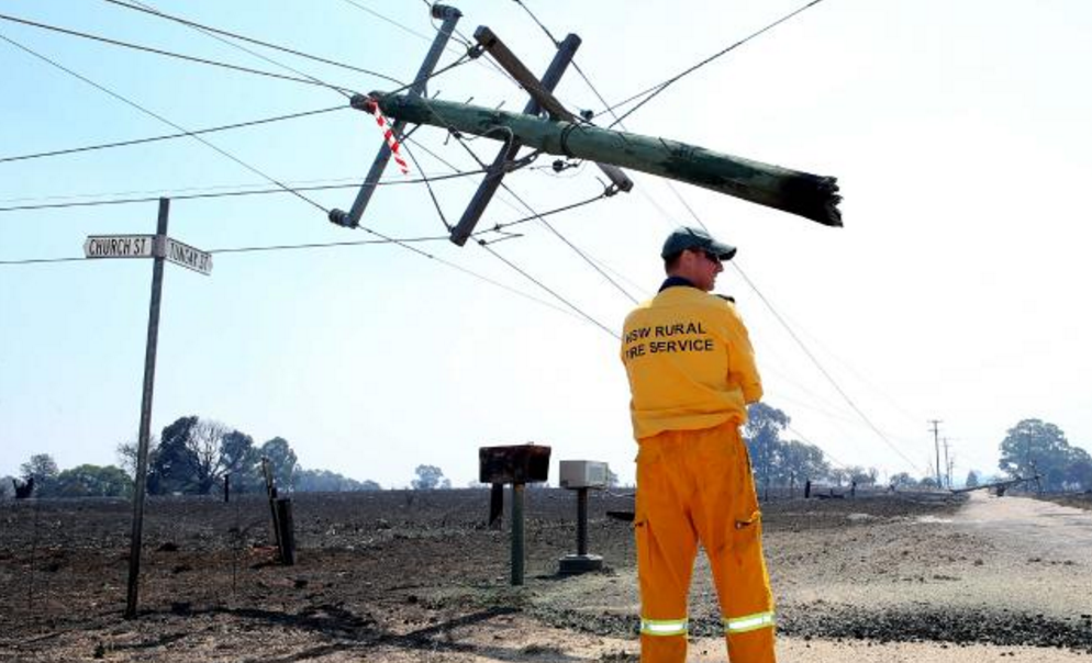 Disaster zone.... a power pole hangs dangerously in the air in Uarbry. Picture: Peter Lorimer.