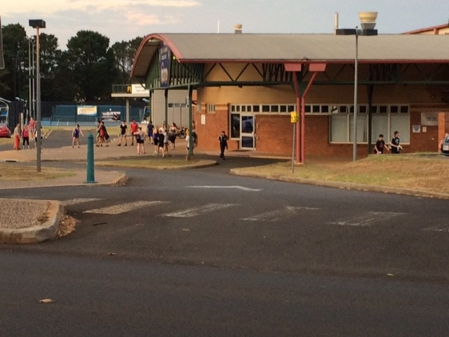 University of Southern Queensland security staff escort people out of the Clive Berghofer Recreation Centre which has been closed overnight due to an incident. Police are on scene.
