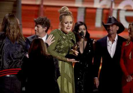 Adele accepts the award for album of the year for
