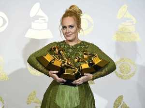 "Adele poses in the press room with the awards for album of the year for ""25"", song of the year for ""Hello"", record of the year for ""Hello"", best pop solo performance for ""Hello"", and best pop vocal album for ""25"" at the 59th annual Grammy Awards. (Photo by Chris Pizzello/Invision/AP)"