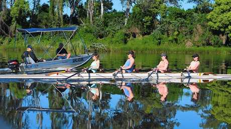 HARD WORK: Visiting rowers getting fined-tuned by local Grafton Rowing Club coach Ken Maughan (in boat).