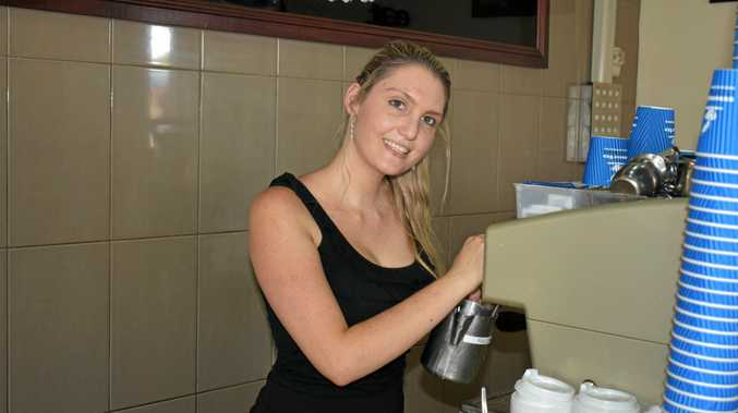 NOT ALL ABOUT COFFEE: A familiar face at The Decks on Mary for the past two years, Kayla Wilson froths milk ready for a cappuccino.