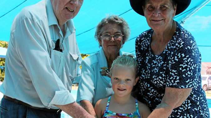ANNIVERSARY: Cutting the Allora Swimming Club 50th anniversary cake are life members Noel May and Heather Slatter, life member and club patron Marg Rackley and youngest club member in attendance Chloe Harm.