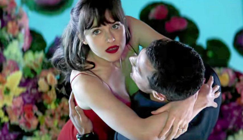 Dakota Johnson and Jamie Dornan in a scene from the extended trailer for the movie Fifty Shades Darker.