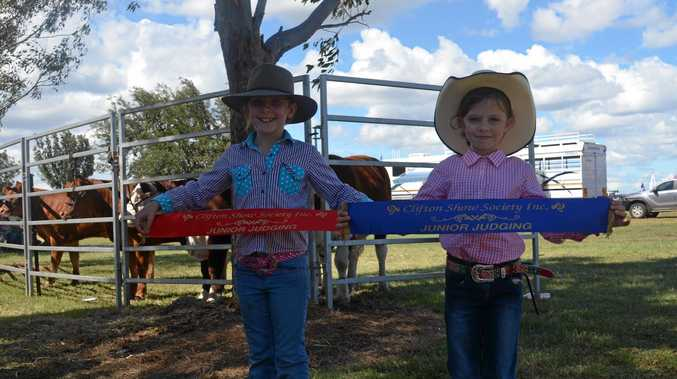 Holly Densley and Mackenzie Taylor winning second and first place in the under 12 junior judging at Clifton Show.